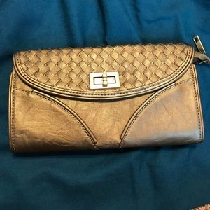 Bronze crossbody clutch